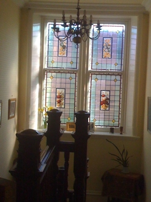 A beautiful stained glass window on the landing